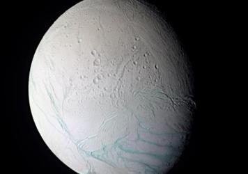 """This false-color image of Enceladus shows so-called """"tiger stripes"""" across the moon's icy surface. Researchers believe the stripes are caused by an ocean beneath the ice."""