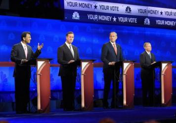 Republican presidential candidates, from left, Bobby Jindal, Rick Santorum, George Pataki, and Lindsey Graham take the stage during the CNBC Republican presidential debate at the University of Colorado on Wednesday.