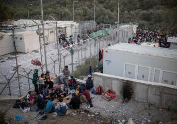 A weary family, who said their passports were lost at sea after their boat was attacked, bounced back and forth between two camps for migrants on Lesbos. Neither the camp reserved for Syrians nor the other for everyone else accepted them.
