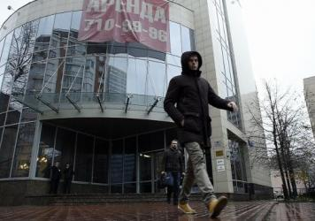 A man walks outside the building that houses Russia's antidoping agency (RUSADA) in Moscow Tuesday. The World Anti-Doping Agency (WADA) has suspended the accreditation for the Moscow anti-doping laboratory.