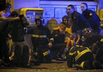 The death toll in the attacks was 127, French President Francois Hollande announced Saturday morning.