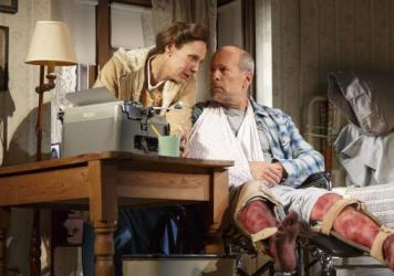 Laurie Metcalf portrays Annie Wilkes, left, and Bruce Willis portrays Paul Sheldon in <em>Misery</em>, currently playing at the Broadhurst Theatre in New York.