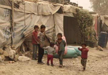 Canada has pledged to accept 25,000 Syrian refugees, likely including women, children and injured people who have been living in camps in Turkey, Lebanon and Jordan. Here, children stand outside their tents during a sandstorm, in a refugee camp in Lebano