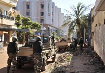 Officers in Mali evacuate bodies of victims from the Radisson Blu hotel in the capital of Bamako Friday, after gunmen seized the hotel and trapped people inside.