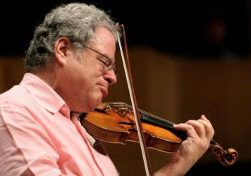 Israeli violinist Itzhak Perlman in 2009, playing his Stradivarius during a rehearsal with musicians from the Simón Bolívar National Youth Orchestra in Caracas, Venezuela.