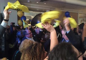 Supporters of Louisiana Gov.-elect John Bel Edwards celebrate his win.