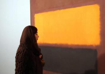 "An Iranian woman looks at the painting ""Sienna, Orange Black on Dark Brown"" by artist Mark Rothko during the opening of an exhibition at Tehran's Museum of Contemporary Art on Nov. 20. Iran amassed a spectacular collection of modern Western art in the 1970s under Shah Reza Pahlavi, but it has rarely been on display since the 1979 Islamic Revolution."