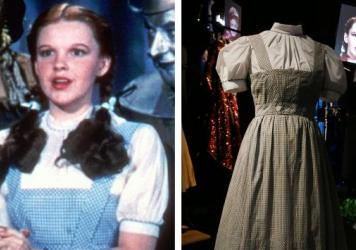Judy Garland is seen as Dorothy in <em>Wizard of Oz</em>, wearing her blue and white dress, and one of the dresses made for the movie is displayed in London.