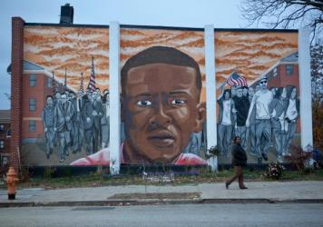 A mural for Freddie Gray is seen at the intersection of North Mount and Presbury streets where he was arrested in April.