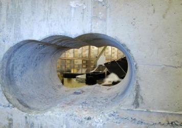 A Metropolitan Police handout shows the hole drilled in the vault wall during the Hatton Garden Safe Deposit company robbery over April's Easter weekend. Eight men, aged between 46 and 76, were charged with conspiracy to burgle.