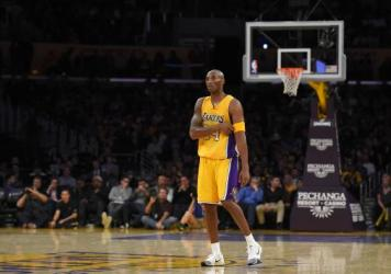 4a7eeb63d564 Los Angeles Lakers forward Kobe Bryant stands on the court during the  second half of an