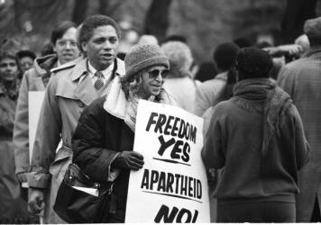 Rosa Parks joins in a march at the South African Embassy in Washington, Dec. 10, 1984, protesting that country's racial policies. She's famous for refusing to give up her seat on a bus in 1955, sparking the Montgomery boycotts — but her activism spa