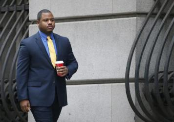William Porter, one of six Baltimore city police officers charged in connection to the death of Freddie Gray, arrives at a courthouse for jury selection in his trial on Monday in Baltimore.
