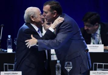 Now-suspended FIFA President Sepp Blatter (left) congratulates Juan Angel Napout after Napout was confirmed as president of CONMEBOL earlier this year.