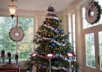 The White House is decked out with 62 Christmas trees and more than 70,000 ornaments this year. The decorations on the East Landing include garlands made of airmail envelops, mailboxes and iPad stations that allow visitors to send messages to military service members.