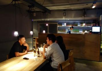 Taiwanese-Australian entrepreneur Jimmy Yang, left, at his Taipei restaurant and bar, Wooloomooloo. Many younger Taiwanese are more focused on work they see as creative and innovative.