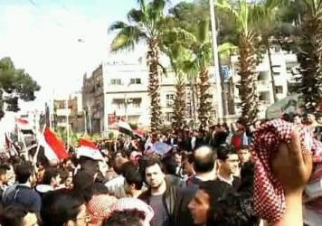 Syrian Aram al-Doumani (center, facing camera) takes part in a peaceful protest against Syrian President Bashar Assad in Douma, Syria, in 2011. Doumani, who now runs an opposition news agency in Syria, says he is skeptical of a breakthrough in cease-fire talks.