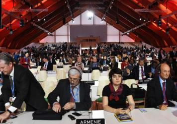 Delegates attend a plenary session at the COP21 United Nations Climate Conference.