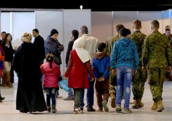 Syrian refugees wait at Marka Airport in Amman, Jordan, this week to complete their migration procedures to Canada.