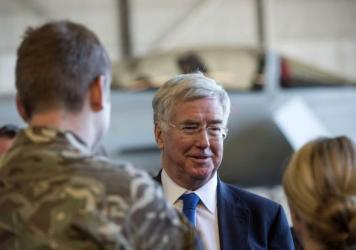 "Michael Fallon, British secretary of state for defense, talks to forces at a British air base in Cyprus on Dec. 5, days after <a href=""http://www.npr.org/sections/thetwo-way/2015/12/02/458227150/british-lawmakers-vote-to-extend-bombing-campaign-to-syria"""