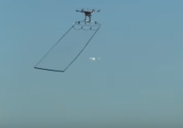 Tokyo's police drone swoops in on another drone. It is equipped with a net to entangle suspicious drones if they enter restricted airspace.