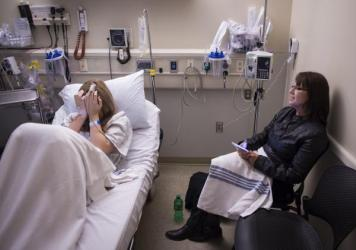 Bonnie Schaan talks to her daughter Cheyeanne Fitzgerald, 16, as she cries at Mercy Medical Center in Roseburg, Ore., on Thursday, November 19, 2015.
