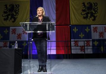 French far-right National Front party leader Marine Le Pen makes a statement after her party lost the second round of France's regional elections on December 13, 2015, in Henin-Beaumont, France. The party achieved record gains in the first round.
