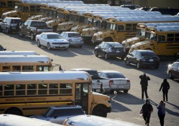 """Los Angeles Unified school district buses sit idle following an """"electronic threat"""" on Tuesday. More than 600,000 students were being sent home or told not to come to school."""