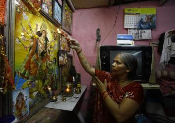 Usha Devi, who was treated for cervical cancer, prays at her house in Mumbai, India. Cervical cancer is one of the top four cancers in the developing world.
