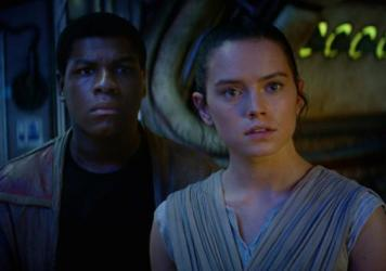 John Boyega and Daisy Ridley in <em>Star Wars: The Force Awakens</em>.