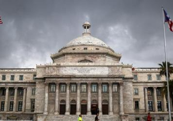 The Puerto Rican capitol building in San Juan is seen on July 1, 2015. The island's residents are struggling to cope with the government's $72 billion debt.