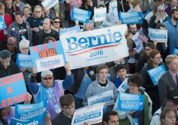 Bernie Sanders supporters walk to the Iowa Events Center before the Jefferson-Jackson dinner in October in Des Moines.