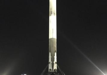 A handout picture made available by SpaceX shows a Falcon 9 rocket landing upright at Cape Canaveral Air Force Station in Florida. SpaceX successfully returned a rocket to Earth following Monday's satellite launch after two earlier attempts failed.