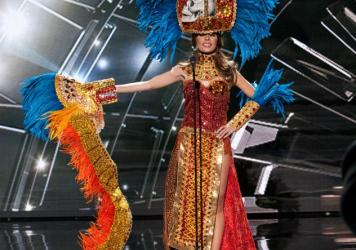 In the Miss Universe parade of national costumes, Iroshka Lindaly Elvir, Miss Honduras, wore a skull on her headdress and had a train of skulls. What did they symbolize?