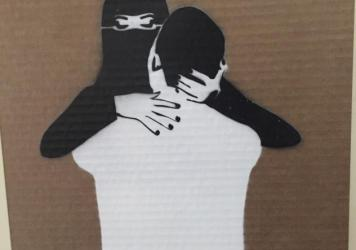 "A veiled woman and a man embrace in a painting at the recent art exhibition ""LoudArt,"" an annual event in the Saudi Arabian city of Jeddah. The exhibit, curated by a woman, often challenges conservative traditions in the kingdom."