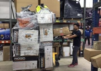 Employee Marvin Whitehead scans returned items so they can be resold at the Optoro warehouse in Lanham, Md.