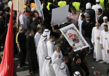 Saudis carry a poster in May demanding freedom for jailed Shiite cleric Sheikh Nimr al-Nimr. Nimr was executed on Saturday.