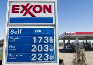 Prices, as seen at a gas station in Woodbridge, Va., on Tuesday, are 21 cents a gallon cheaper than this time last year. The drop violates the historic rule that tension such as that currently between key producers Saudi Arabia and Iran causes the cost o