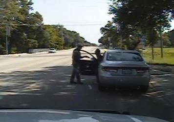 In this frame from the dashcam video Texas State Trooper Brian Encinia confronts Sandra Bland after a minor traffic infraction. She was later arrested and found hanged in her jail cell.