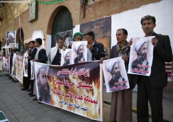 "Shiite rebels hold posters of <a href=""http://www.npr.org/sections/thetwo-way/2016/01/04/461912757/who-was-the-shiite-sheikh-executed-by-saudi-arabia"">late Shiite cleric Nimr al-Nimr</a> at a protest Thursday in Sanaa, Yemen. The cleric's execution by Saudi Arabia on Saturday sparked a dramatic deterioration in relations between Saudi and Iran."