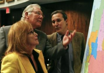 Florida state Sens. (left-right) Eleanor Sobel, Greg Evers, R-Baker, Rene Garcia discuss a congressional redistricting map on the floor of the Senate in 2014.