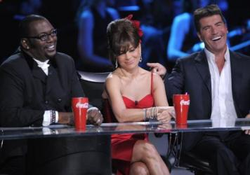 Original <em>American Idol </em>judges Randy Jackson, Paula Abdul and Simon Cowell on stage in 2008.