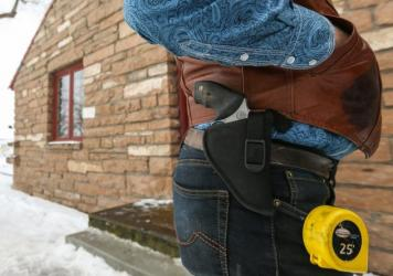 The armed individuals occupying part of the Malheur National Wildlife Refuge in Oregon include Ryan Bundy. On Thursday, he had a gun and a tape measure on his side. Bundy is the son of Cliven Bundy, whose 2014 armed standoff with the federal Bureau of La