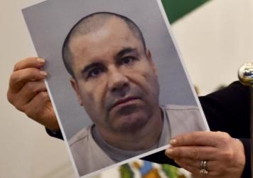 "Mexican drug kingpin Joaquin ""El Chapo"" Guzmán, seen here in a photo held by Mexico's attorney general, Arely Gomez, last July, has been recaptured, Mexico's president says."