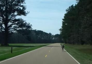 Kurt Searvogel on the road, early in his year-long cycling feat.