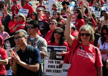 More than 300,000 California teachers are represented by unions like the California Teachers Association, seen here protesting proposed budget cuts in 2011. Nine percent of those California teachers have not joined the union, but under state law, any union contract must cover them too, so they are required to pay an amount that covers the costs of negotiating the contract and administering it.
