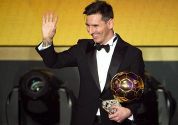 Lionel Messi of Argentina and Barcelona FC waves after winning the FIFA Ballon d'Or in Zurich, Switzerland.