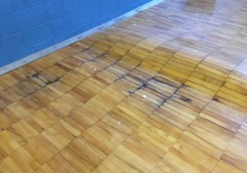 "Disrepair — such as this floor in the gym of Noble Elementary-Middle School in Detroit — and other problems have prompted the teachers' ""sickout"" protests."