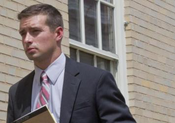 Former Alabama police Officer Eric Parker, seen in September, has been acquitted of a federal charge of violating a man from India's rights by using excessive force.