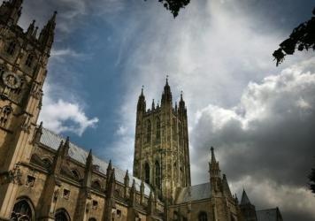 Canterbury Cathedral, the mother church of the international Anglican Communion, stands under clouds in 2008, in Canterbury, England. A church meeting this week on the issue of same-sex marriage has resulted in a three-year sanction of the Episcopal Chur